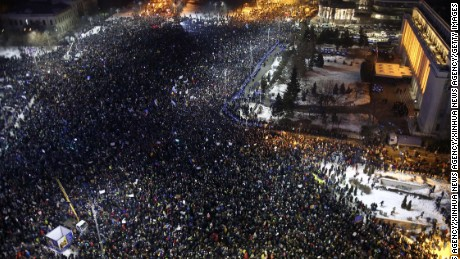 Scores of people demonstrating against corruption reforms in Bucharest on Thursday.