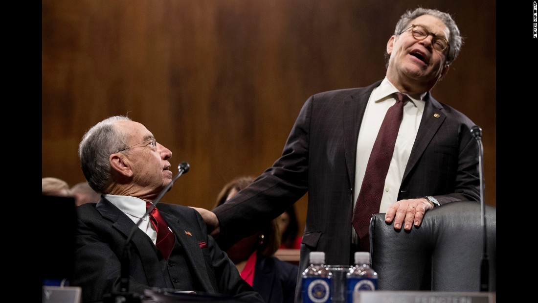 US Sens. Charles Grassley, left, and Al Franken speak together before the Senate Judiciary Committee met to discuss US Sen. Jeff Sessions, the President's pick for attorney general, on Tuesday, January 31.