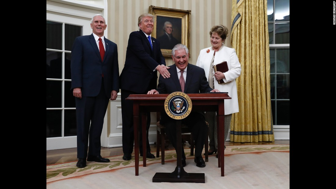 "Trump puts his hand on the shoulder of Secretary of State Rex Tillerson after <a href=""http://www.cnn.com/2017/02/01/politics/tillerson-confirmation-vote-senate/"" target=""_blank"">Tillerson was sworn in</a> on Wednesday, February 1. They are joined by Vice President Mike Pence and Tillerson's wife, Renda St. Clair."