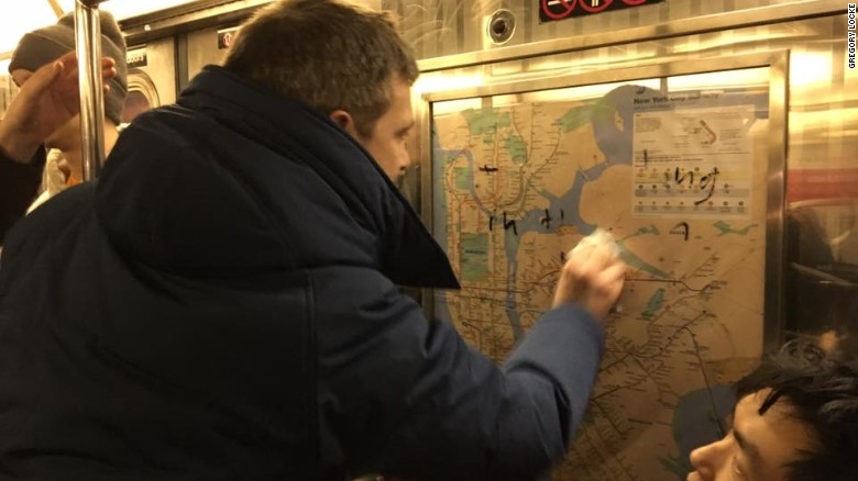 New Yorkers scrub hateful graffiti from subway