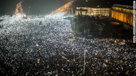 Protesters in Bucharest, Romania, turn on their cell phone lights en masse Sunday night.