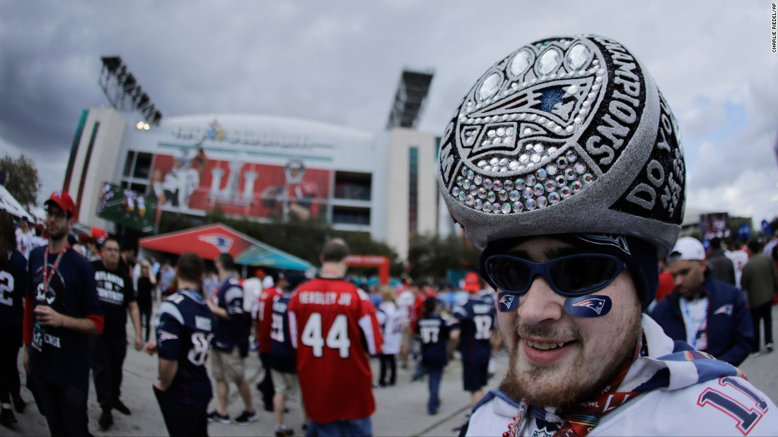 "A Patriots fan wears a hat that looks like a giant Super Bowl ring. <a href=""http://www.cnn.com/2015/01/23/us/gallery/super-bowl-rings/index.html"" target=""_blank"">See all of the Super Bowl rings</a>"