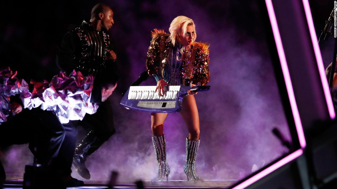 Gaga plays the keytar.