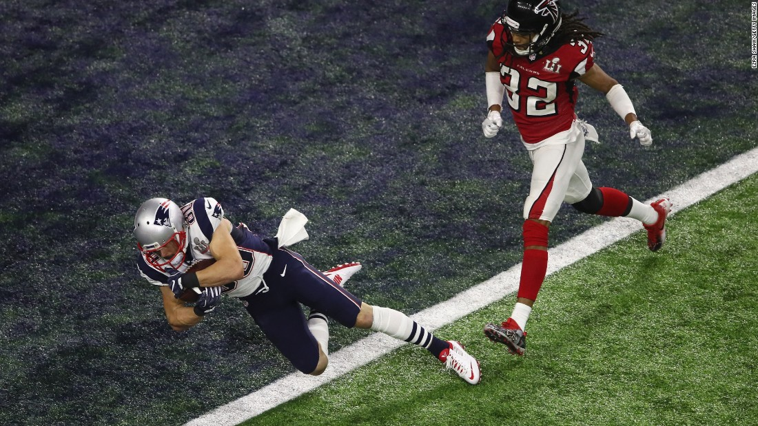 Danny Amendola catches a 6-yard touchdown pass for New England in the fourth quarter. After a two-point conversion, the Patriots cut the Falcons' lead to 28-20 with just under six minutes remaining.