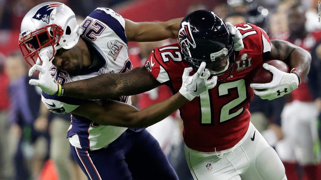 Atlanta wide receiver Mohamed Sanu tussles with New England's Logan Ryan during the second half.