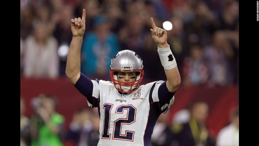 Brady raises his arms after a touchdown late in the second half.