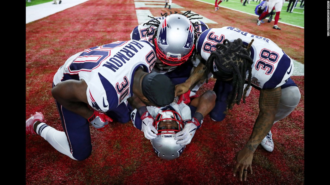 New England running back James White is mobbed by his teammates after scoring the game-winning touchdown in overtime. White ran it in from two yards away after a pass interference penalty on Atlanta.