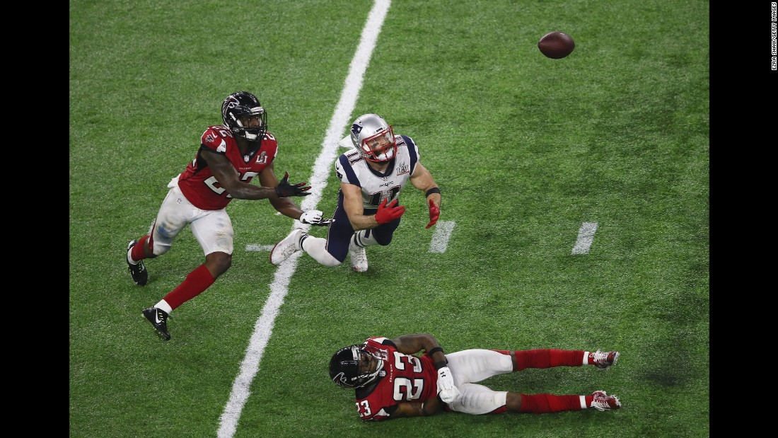 Tom Brady's pass over the middle was deflected by Atlanta cornerback Robert Alford, right. It hung in the air and appeared as though it could be intercepted, ending the Patriots' drive with 2:30 remaining in the game.