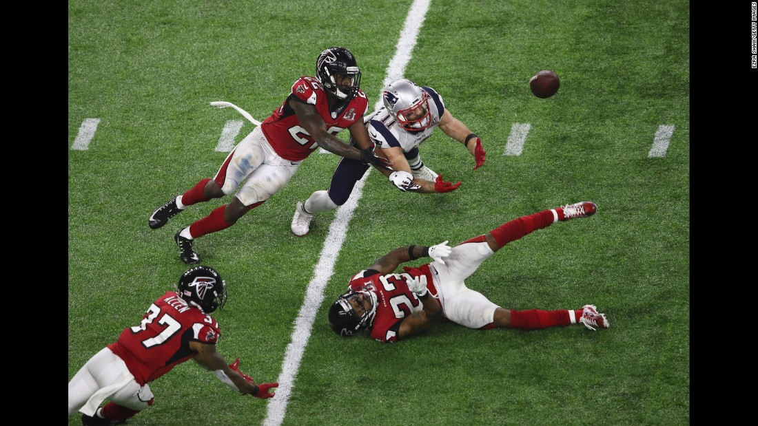 Edelman dove for the ball, as did Atlanta defenders Ricardo Allen, left, and Keanu Neal.
