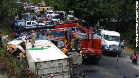 EDITORS NOTE: Graphic content / View after a bus and a truck crashed on the road that links the Honduran capital with the south of the country, near Germania, 11 km south of Tegucigalpa on February 5, 2017. At least 12 people were killed and 35 injured of some 70 who were on board the bus. / AFP / ORLANDO SIERRA        (Photo credit should read ORLANDO SIERRA/AFP/Getty Images)