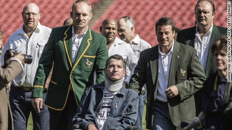 Van der Westhuizen (C), during a re-enactment of the team photo from the 1995 Rugby World Cup final.