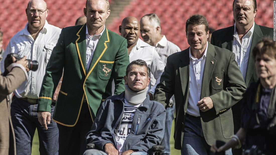 After being diagnosed with motor neurone disease in 2011, van der Westhuizen was bound to a wheelchair for the final years of his life. He is pictured in a re-enactment of the team photo from the World Cup victory at Ellis Park in Johannesburg, South Africa.