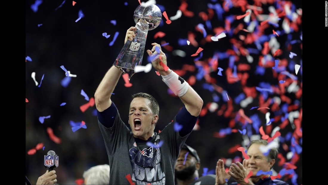 "New England quarterback Tom Brady raises the Vince Lombardi Trophy after leading the Patriots to a 34-28 victory in <a href=""http://www.cnn.com/2017/02/05/sport/gallery/super-bowl-li/index.html"" target=""_blank"">Super Bowl LI</a> on Sunday, February 5. Brady threw for a Super Bowl-record 466 yards as New England completed the biggest comeback in Super Bowl history. The Patriots trailed Atlanta 28-3 in the third quarter but rallied to win in overtime. Brady was named the game's Most Valuable Player."