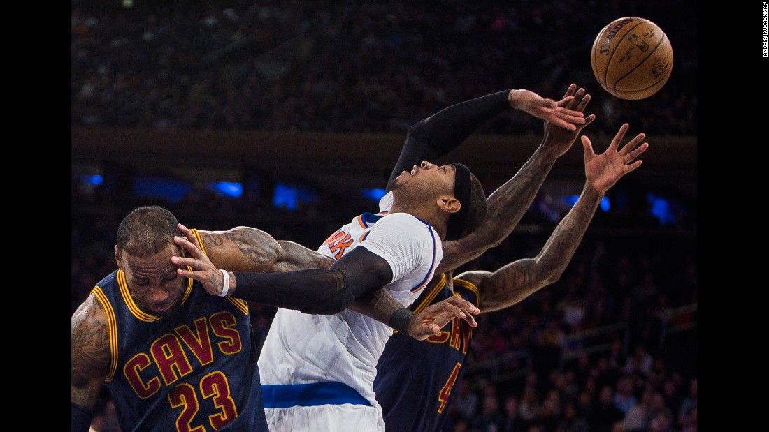 From left, LeBron James, Carmelo Anthony and Iman Shumpert compete for the ball during an NBA basketball game in New York on Saturday, February 4.