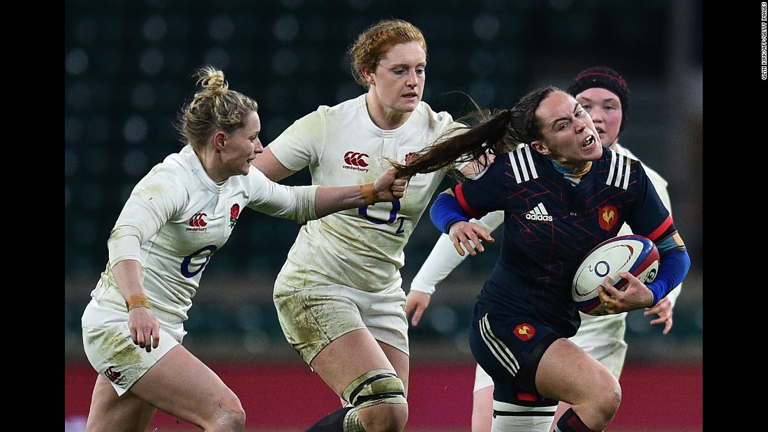 French rugby player Jade Le Pesq has her hair pulled by England's Natasha Hunt during a Six Nations match in London on Saturday, February 4.