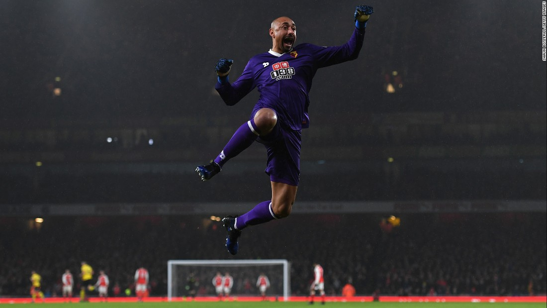 Watford goalkeeper Heurelho Gomes celebrates his team's second goal during its 2-1 upset of Arsenal on Tuesday, January 31. The Premier League match was played in London.