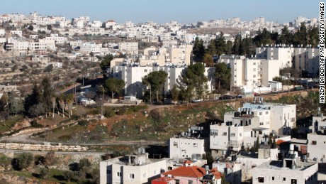 A picture taken from the West Bank city of Hebron on February 7, 2017 shows a view of the Kiryat Arba Jewish settlement on the outskirts of the Palestinian city. / AFP / HAZEM BADER        (Photo credit should read HAZEM BADER/AFP/Getty Images)