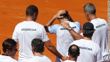BUENOS AIRES, ARGENTINA - FEBRUARY 06:  Guido Pella of Argentina walks off the field with teammates after losing a singles match between as part of day 3 of the Davis Cup 1st round match between Argentina and Italy at Parque Sarmiento on February 06, 2017 in Buenos Aires, Argentina. (Photo by Gabriel Rossi/LatinContent/Getty Images)