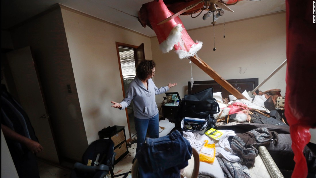 Artie Chaney surveys the damage to her home in New Orleans. The tornado hit while she and her family took cover inside.