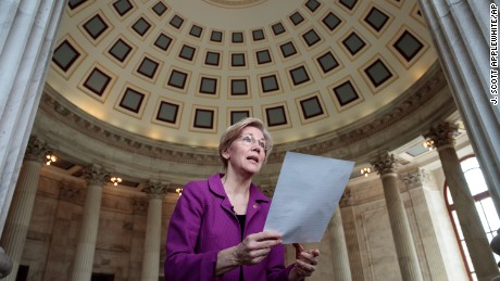 Holding a transcript of her speech in the Senate Chamber, Sen. Elizabeth Warren, D-Mass. reacts to being rebuked by the Senate leadership and accused of impugning a fellow senator, Attorney General-designate, Sen. Jeff Sessions, R-Ala., Wednesday, Feb. 8, 2017, on Capitol Hill in Washington. Warren was barred from saying anything more on the Senate floor about Sessions after she quoted from an old letter from Martin Luther King Jr.'s widow about Sessions. (AP Photo/J. Scott Applewhite)