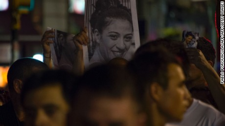 People hold pictures of Valeria Sosa (29) during a demonstration to condemn violence against women in Montevideo on February 2, 2017. Sosa, who was shot dead by her husband, a policeman, is the fourth woman victim of domestic violence in Uruguay so far this year.   / AFP / Pablo PORCIUNCULA        (Photo credit should read PABLO PORCIUNCULA/AFP/Getty Images)