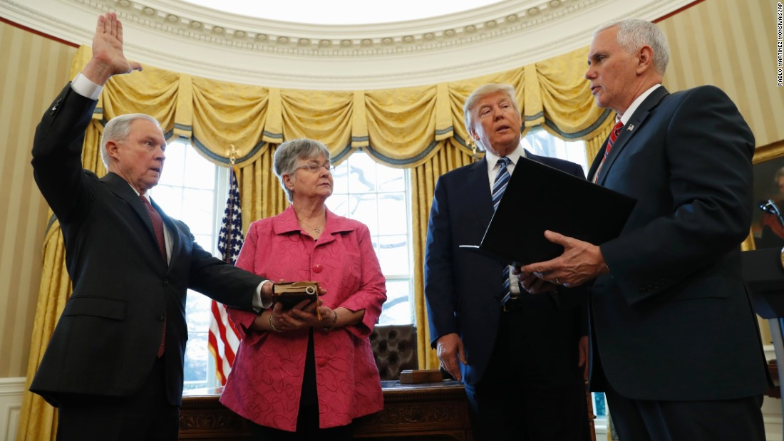 "Trump watches as Pence administers the oath of office to Attorney General Jeff Sessions in the White House Oval Office on Thursday, February 9. Sessions, one of Trump's closest advisers and his earliest supporter in the Senate, was confirmed <a href=""http://www.cnn.com/2017/02/08/politics/jeff-sessions-vote-senate-slog/"" target=""_blank"">by a 52-47 vote</a> that was mostly along party lines. He was accompanied to the swearing-in by his wife, Mary."