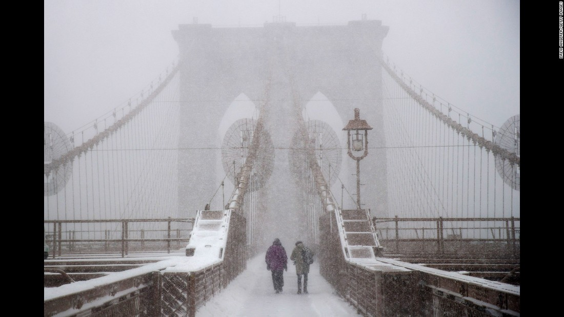 People walk across the Brooklyn Bridge in New York on February 9.