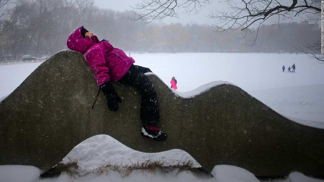 Lina Lennerz rests on a sculpture at a park in Brookline, Massachusetts, on February 9.