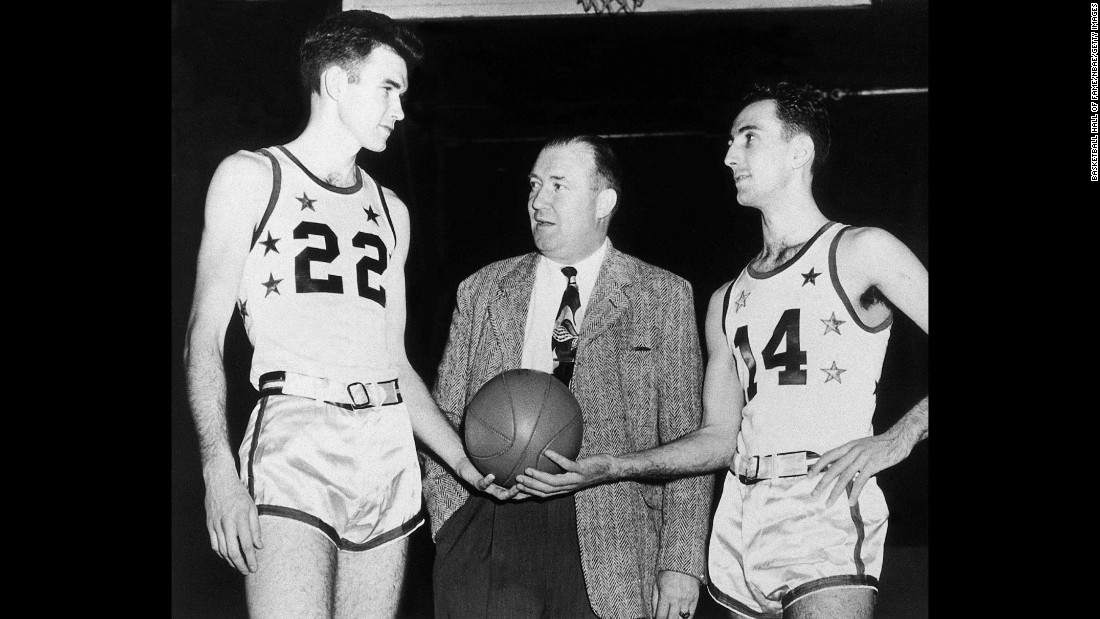 <strong>First All-Star MVP:</strong> Ed Macauley, left, was MVP of the first NBA All-Star Game, which was played in 1951. Boston teammate Bob Cousy, right, was also on the team that year. Between them here is Walter Brown, the Celtics' original owner.