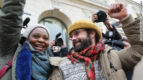 French farmer Cedric Herrou (R) gestures next to a Malian woman named Khadidja as he leaves the Nice court house on February 10, 2017, after his trial for illegally assisting migrants.
