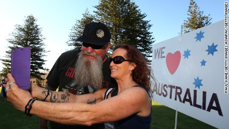 FREMANTLE, AUSTRALIA - JANUARY 26:  A couple take a selfie in front of a We Love Australia placard following the Reclaim Australia Day Rally at the Esplanade on January 26, 2017 in Fremantle, Australia. Fremantle Council will hold an alternative celebration on Saturday 28 January, following growing pressure around the country to change the date of Australia Day to one more sensitive to Indigenous Australians. Local Fremantle businesses raised the money to hold the traditional Australia Day fireworks on the 26th despite the Council's decision. Australia Day, formerly known as Foundation Day, is the official national day of Australia and is celebrated annually on January 26 to commemorate the arrival of the First Fleet to Sydney in 1788.  (Photo by Paul Kane/Getty Images)