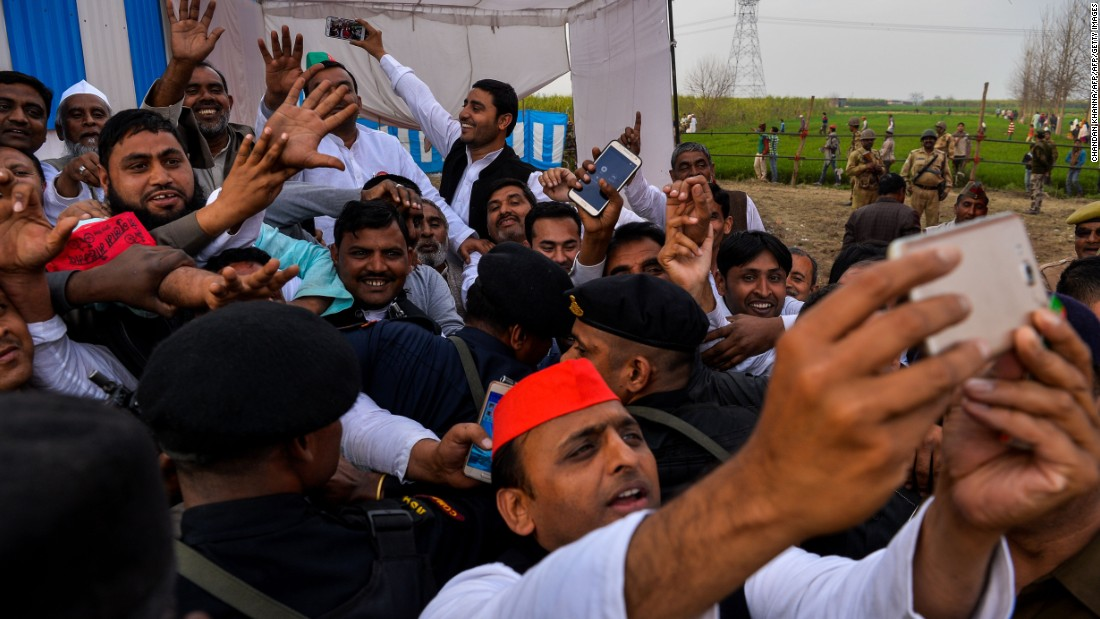 Sitting Chief Minister Akhilesh Yadav of the Samajwadi Party takes a selfie with a phone during a public rally in February 2017.