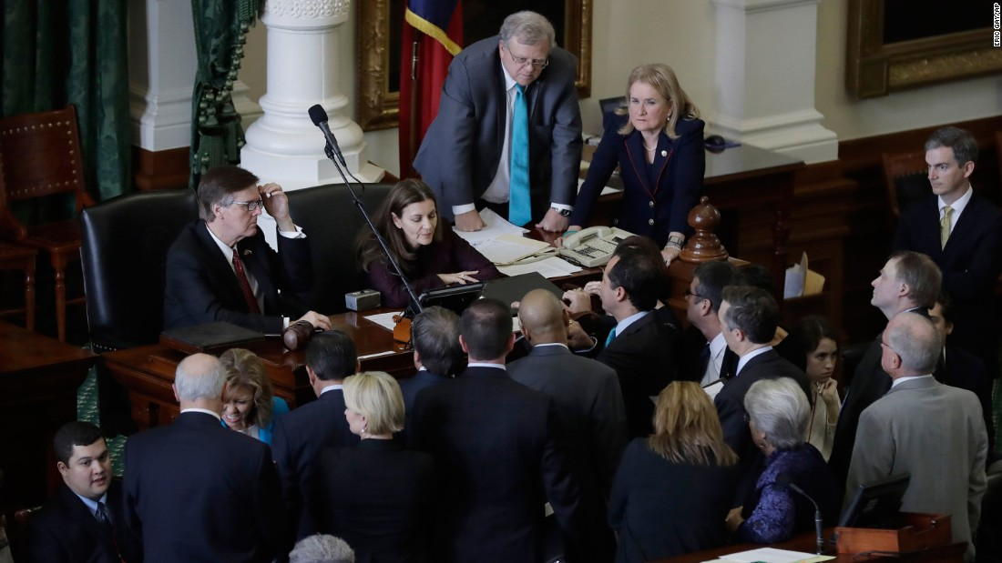 "Texas state senators gather around Lt. Gov. Dan Patrick, back left, during a debate over a bill on Tuesday, February 7. The Senate <a href=""http://www.cnn.com/2017/02/07/us/texas-sanctuary-city-fight/"" target=""_blank"">cleared a bill</a> that would withhold state dollars for ""sanctuary cities"" where police fail to enforce immigration laws at the request of federal officials. The measure came just days after President Trump signed an executive order that strips states and cities of federal funding if they ""attempt to shield aliens from deportation."""