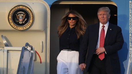 WEST PALM BEACH, FL - FEBRUARY 10:  President Donald Trump and his wife Melania Trump arrive on Air Force One at the Palm Beach International airport as they prepare to spend part of the weekend with  Japanese Prime Minister Shinzo Abe and his wife Akie Abe at Mar-a-Lago resort on February 10, 2017 in West Palm Beach, Florida. The two are scheduled to get in a game of golf as well as discuss trade issues.  (Photo by Joe Raedle/Getty Images)