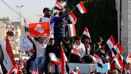 Crowds protest Saturday in Baghdad to back Sadr's call to reform Iraq's electoral commission.