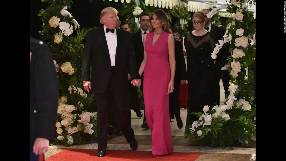 The Trumps arrive for a Red Cross gala at their Mar-a-Lago estate in February 2017.