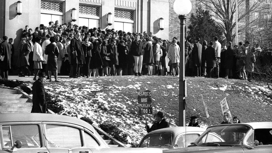 College and universities have long been hubs of free speech -- and hotbeds of protest. In this 1964 photo, civil rights groups picket a speech by Alabama Gov. George Wallace at the <strong>University of Cincinnati</strong> in Cincinnati, Ohio. The controversial Wallace, a leading spokesman for segregation, denounced a newly passed civil rights bill as a federal power grab.