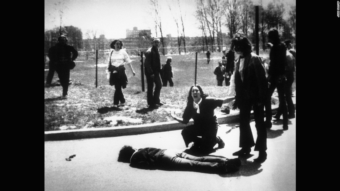 Mary Ann Vecchio screams as she kneels by the body of student Jeffrey Miller, shot by National Guardsmen on May 4, 1970, on the campus of <strong>Kent State University</strong> in Kent, Ohio. The National Guard had been called in to help quell several days of unrest on campus by crowds of demonstrators protesting the war in Vietnam. This photo was published worldwide, won a Pulitzer and helped sway public sentiment against the war.