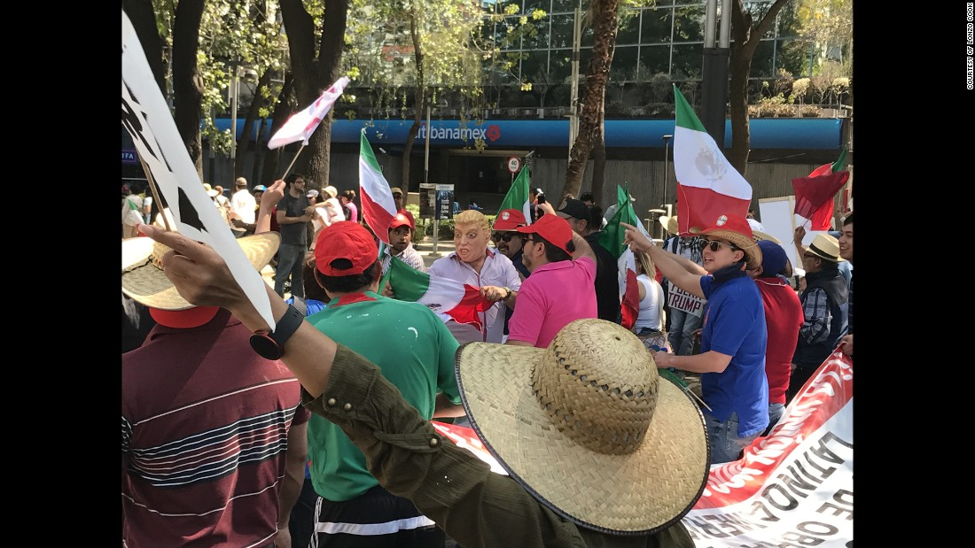 Protesters march in Mexico City.