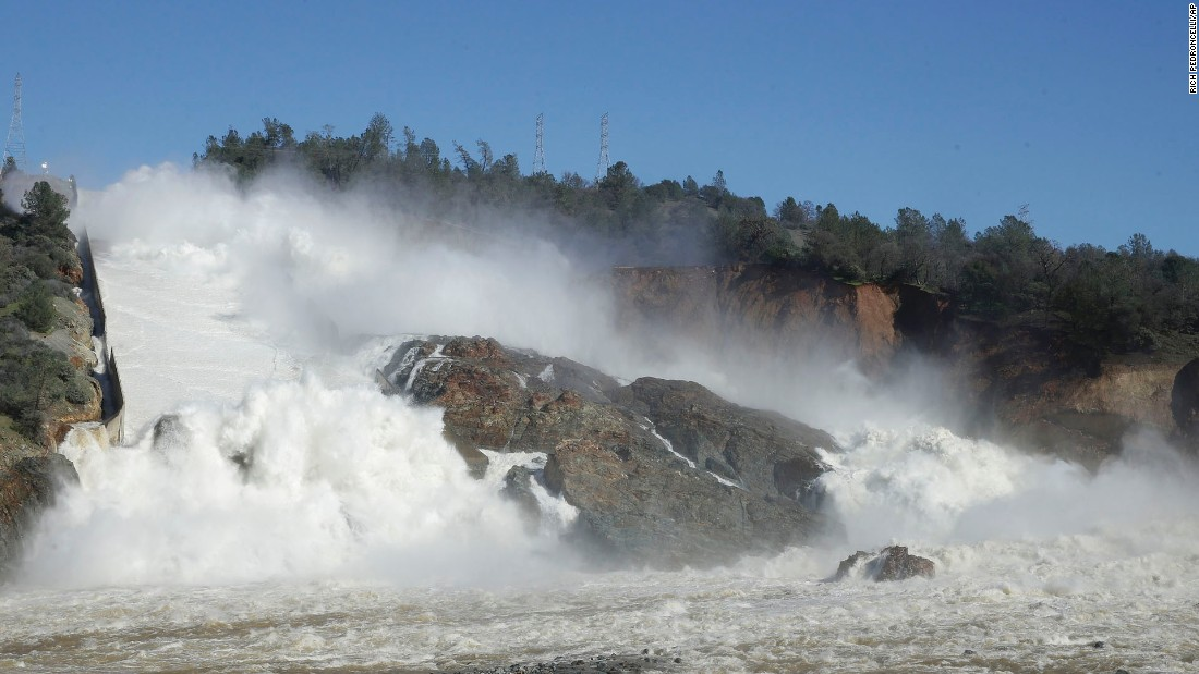 Water gushes over the main spillway at Oroville Dam on February 11.