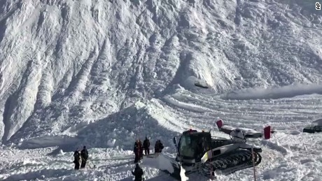 Rescuers work at the site of the avalanche in Tignes, France.