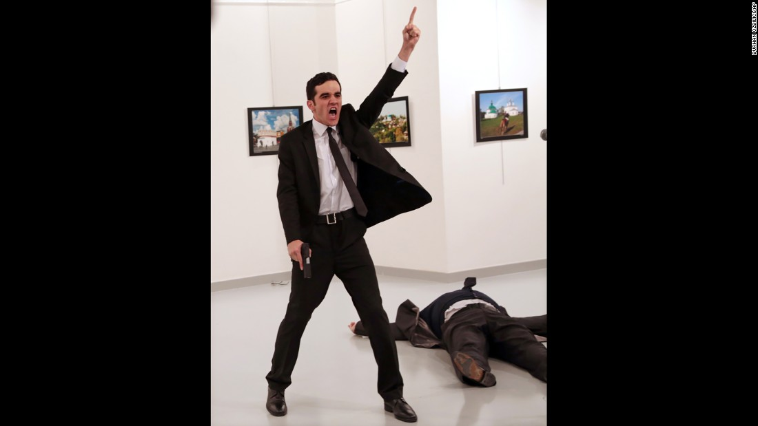 "A gunman gestures after assassinating Andrey Karlov, the Russian ambassador to Turkey, at a photo exhibition in Ankara, Turkey, on December 19. Burhan Ozbilici, an Associated Press photographer, was covering the exhibition when <a href=""http://www.cnn.com/2016/12/19/middleeast/gallery/andrey-karlov-shooting/index.html"" target=""_blank"">the shooting</a> took place. ""I was, of course, fearful and knew of the danger if the gunman turned toward me,"" <a href=""https://apnews.com/eadca282d5d341a79bb464bbadc4fa11"" target=""_blank"">he wrote on APNews.com.</a> ""But I advanced a little and photographed the man as he hectored his desperate, captive audience."" Ozbilici's photos from the scene won first place in the Spot News category for stories."