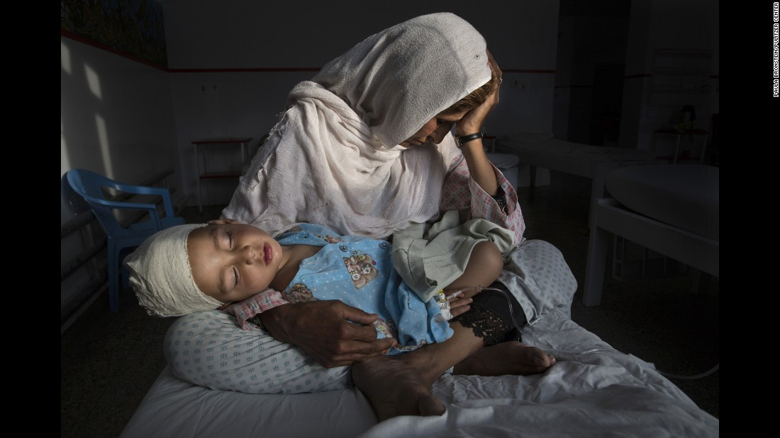 Najiba holds her 2-year-old nephew, Shabir, at a hospital in Kabul, Afghanistan. Shabir was injured in a bomb blast that killed his sister on March 29. Najiba had to stay with the children as their mother buried her daughter.