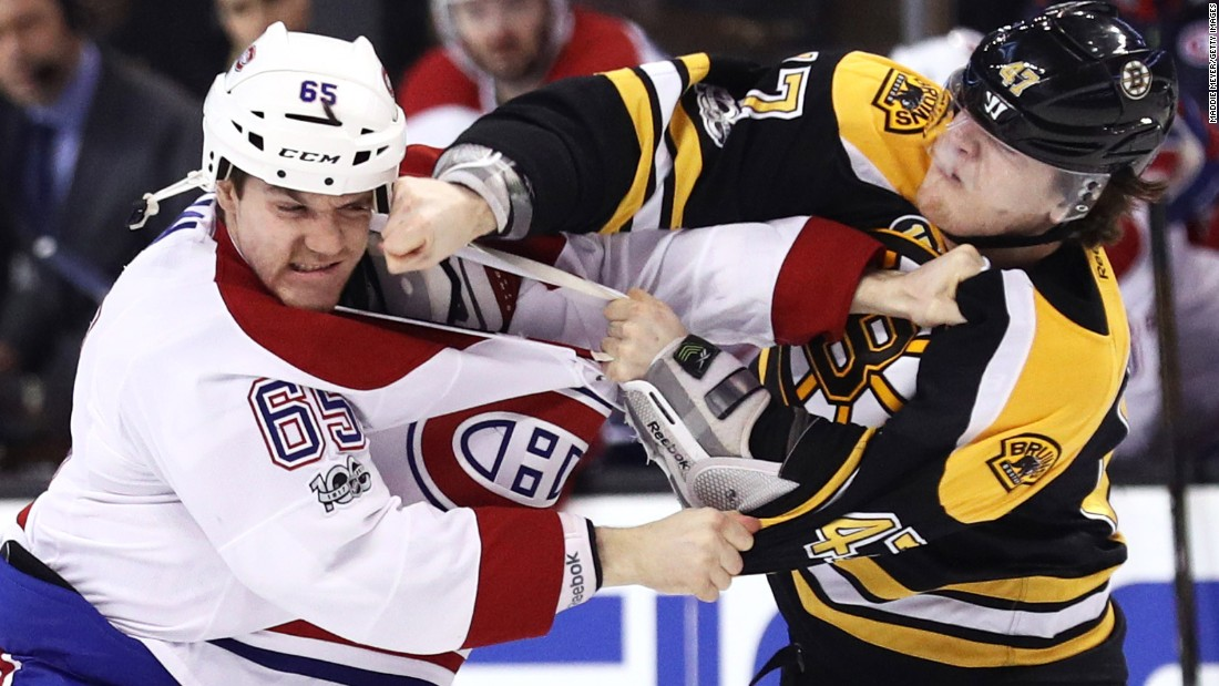 Montreal's Andrew Shaw, left, fights Boston's Torey Krug during an NHL hockey game in Boston on Sunday, February 12.