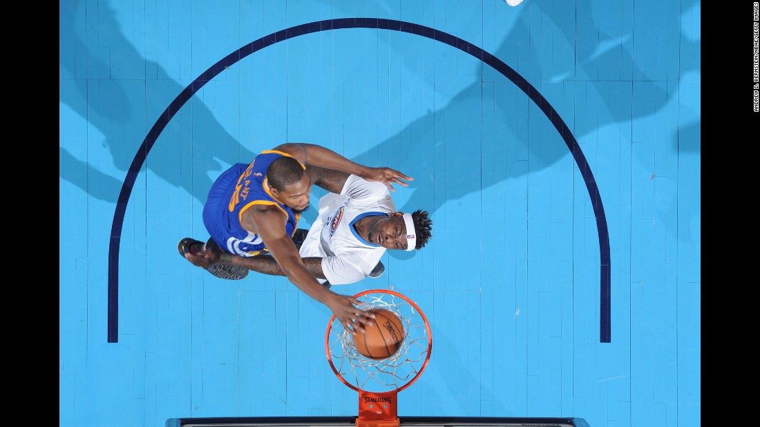 Kevin Durant throws down a dunk against his former team, the Oklahoma City Thunder, during an NBA basketball game on Saturday, February 11. It was Durant's first trip back since signing with Golden State in the offseason. He endured boos from his former fans and scored 34 points in a 130-114 victory.
