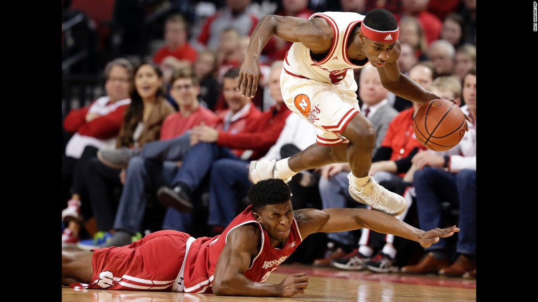 Nebraska's Glynn Watson Jr. leaps over Wisconsin's Khalil Iverson during a college basketball game in Lincoln, Nebraska, on Thursday, February 9.