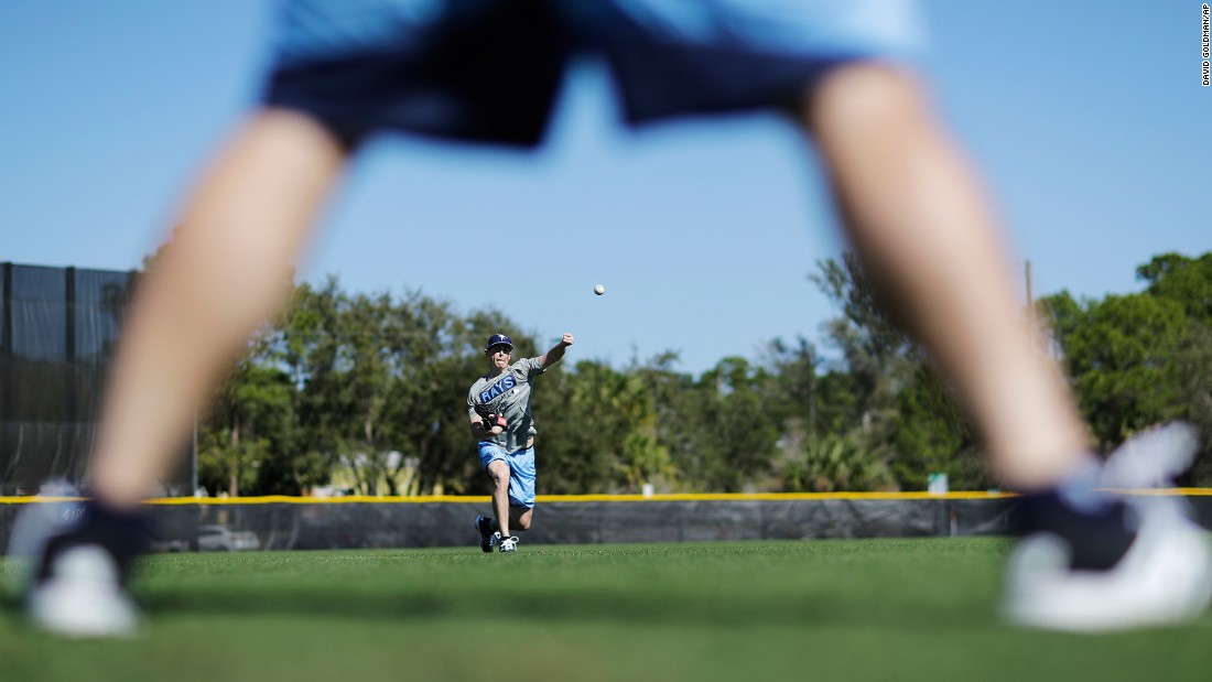 Tampa Bay pitcher Ryan Yarbrough throws the ball during an informal workout in Port Charlotte, Florida, on Sunday, February 12. Spring training begins this week for Major League Baseball.