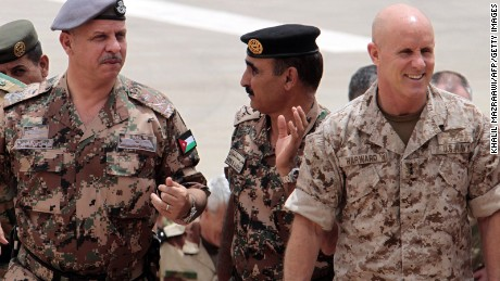 "Then-Navy Vice Admiral Robert S. Harward (right) attends the ""Eager Lion"" joint military exercise at the King Abdullah Special Operations Training Centre in Amman on May 27, 2012."