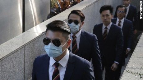 Five of the seven police officers charged with assaulting a pro-democracy activist on October 15, 2014, arriving at a district court in Hong Kong on February 14, 2017.