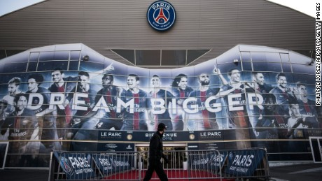 A security personnel walks past Paris Saint-Germain's Parc des Princes stadium, in Paris on February 13, 2017 on the eve of the club's champions league match against FC Barcelona. / AFP / PHILIPPE LOPEZ        (Photo credit should read PHILIPPE LOPEZ/AFP/Getty Images)